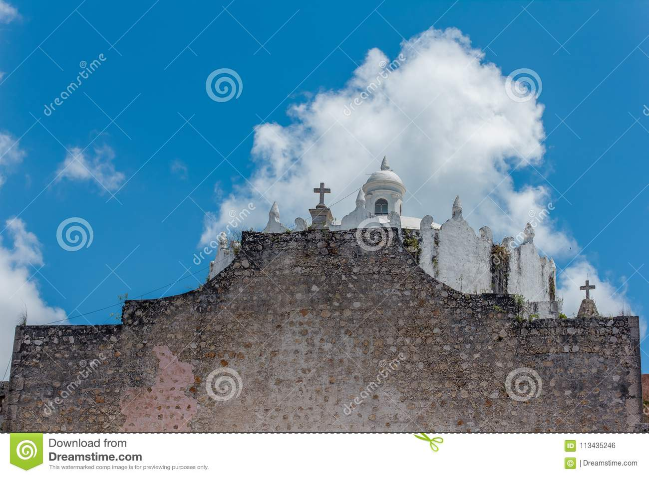 White old church with clouds