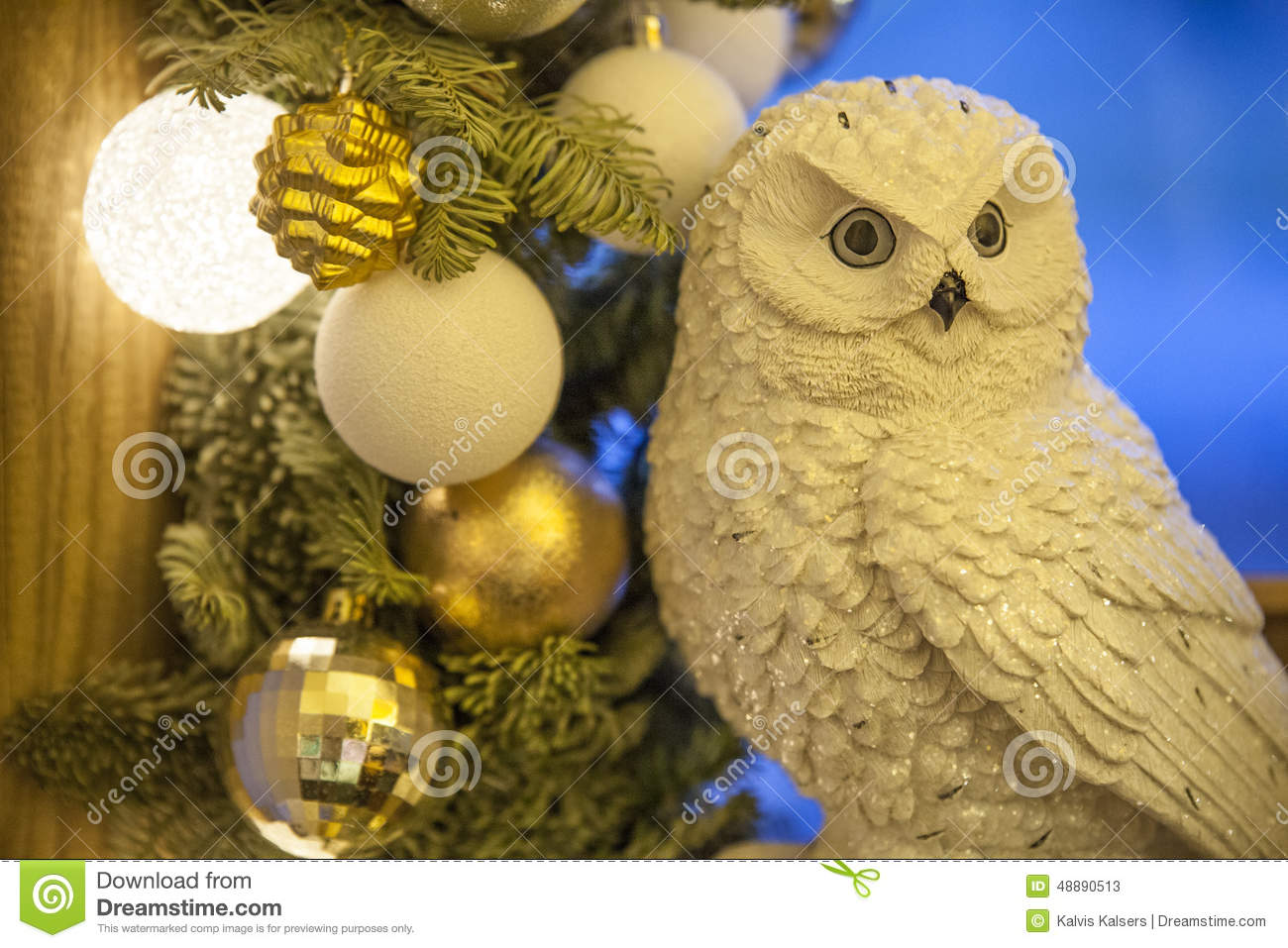 owl with christmas decorations on the blue background