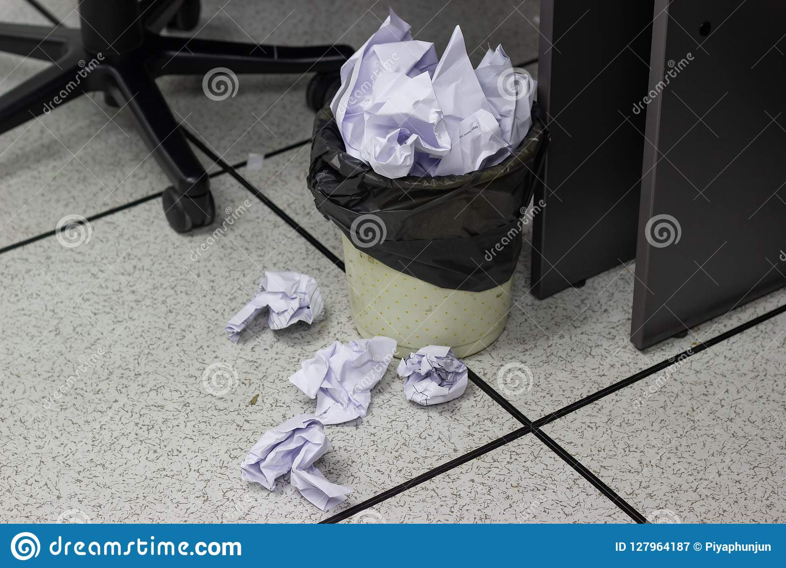 White paper balls into trash in work office