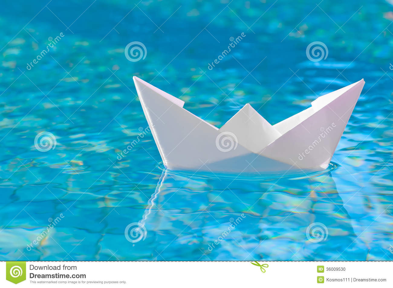 white paper boat floating in the water stock photo 36009530 megapixl