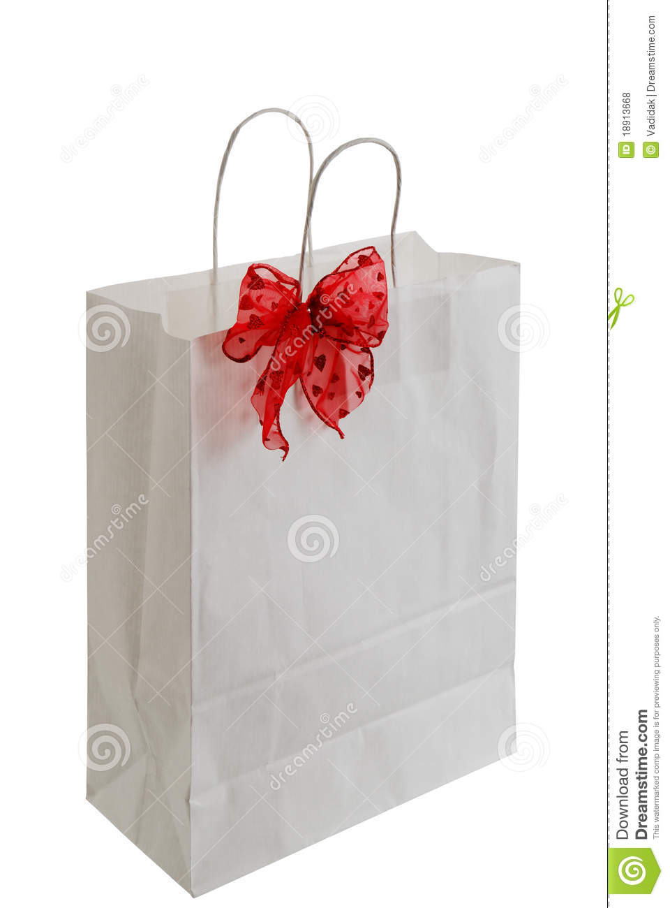 white paper gift bag with red ribbon stock photo