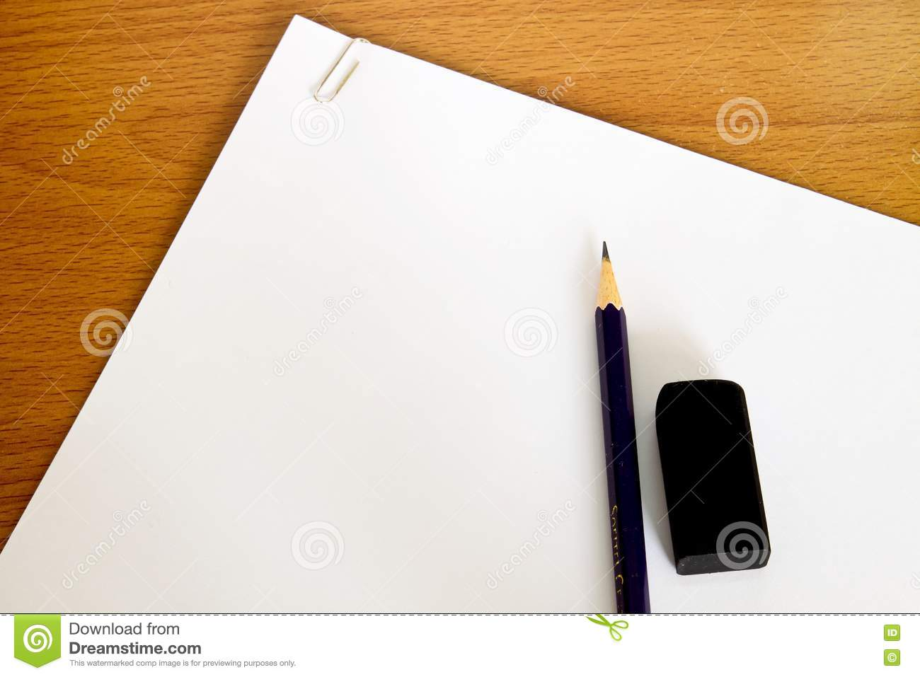 White Paper With Pencil And Rubber On Table Stock Image
