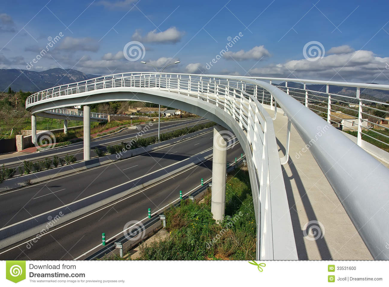White pedestrian bridge over a highway in Majorca (Spain).