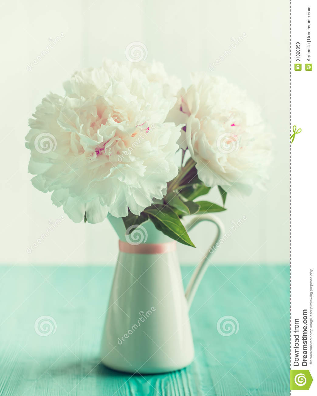 White peonies in floral vase on wooden table vintage mint colors white peonies in floral vase on wooden table vintage mint colors reviewsmspy