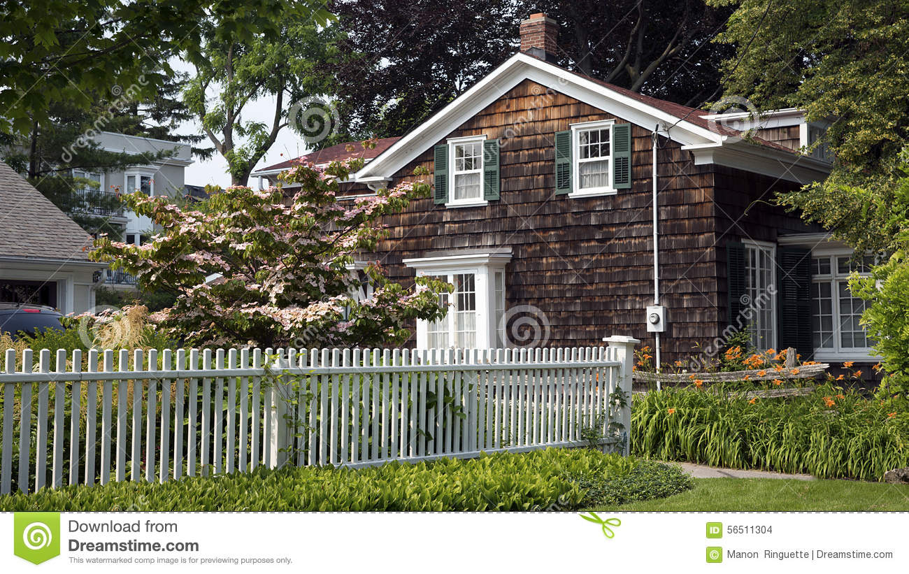 White Picket Fence And Cottage Stock Photo Image Of