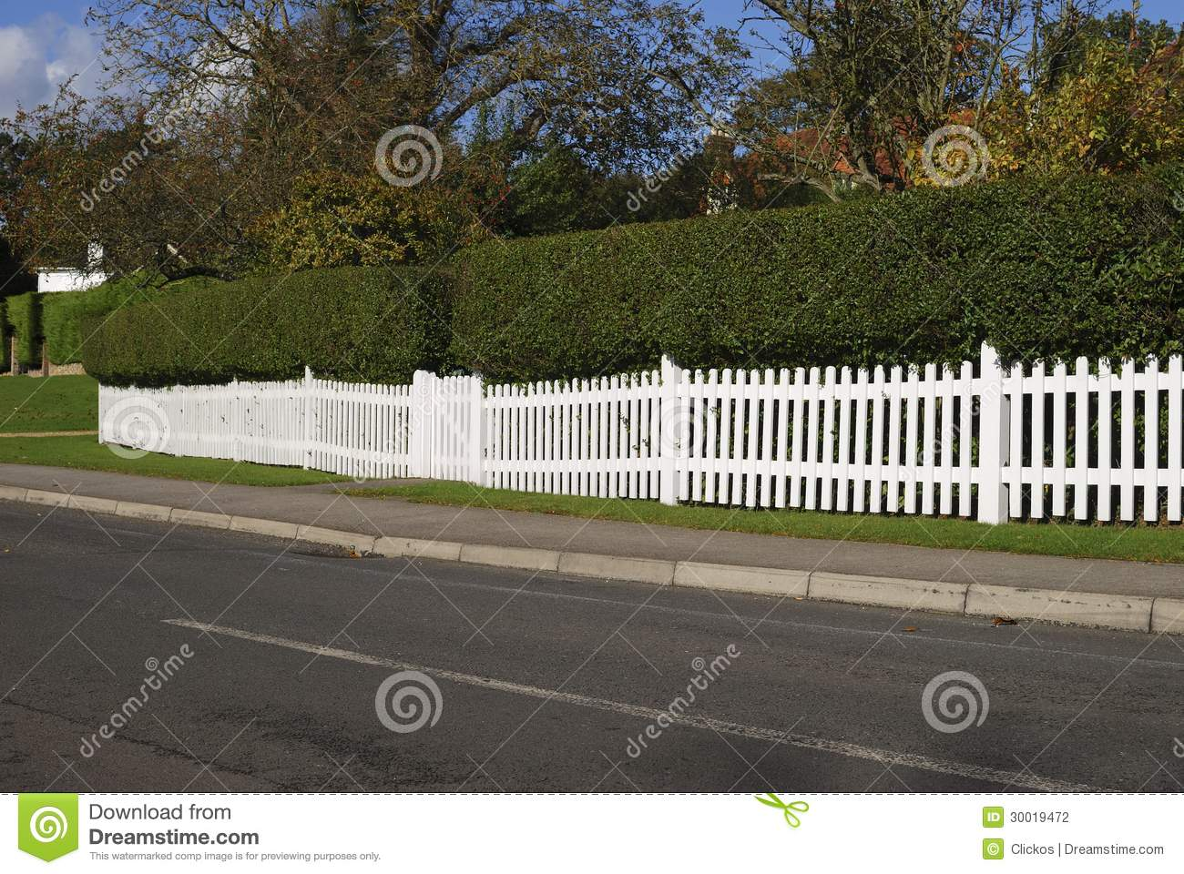 White Picket Fence And Hedge Surrey England Stock