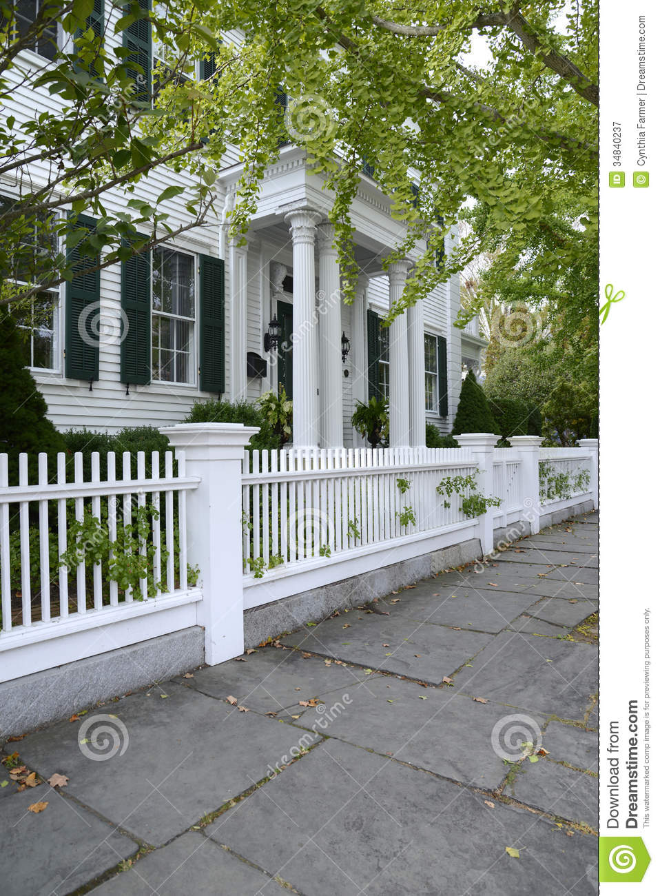 White Picket Fence By A Typical Federal Style House Stock