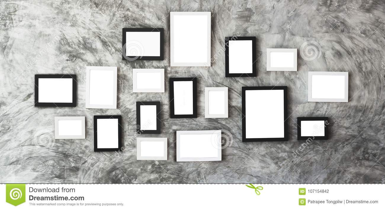 White Picture Frames In Center Of Marble Wall For User Stock Photo ...