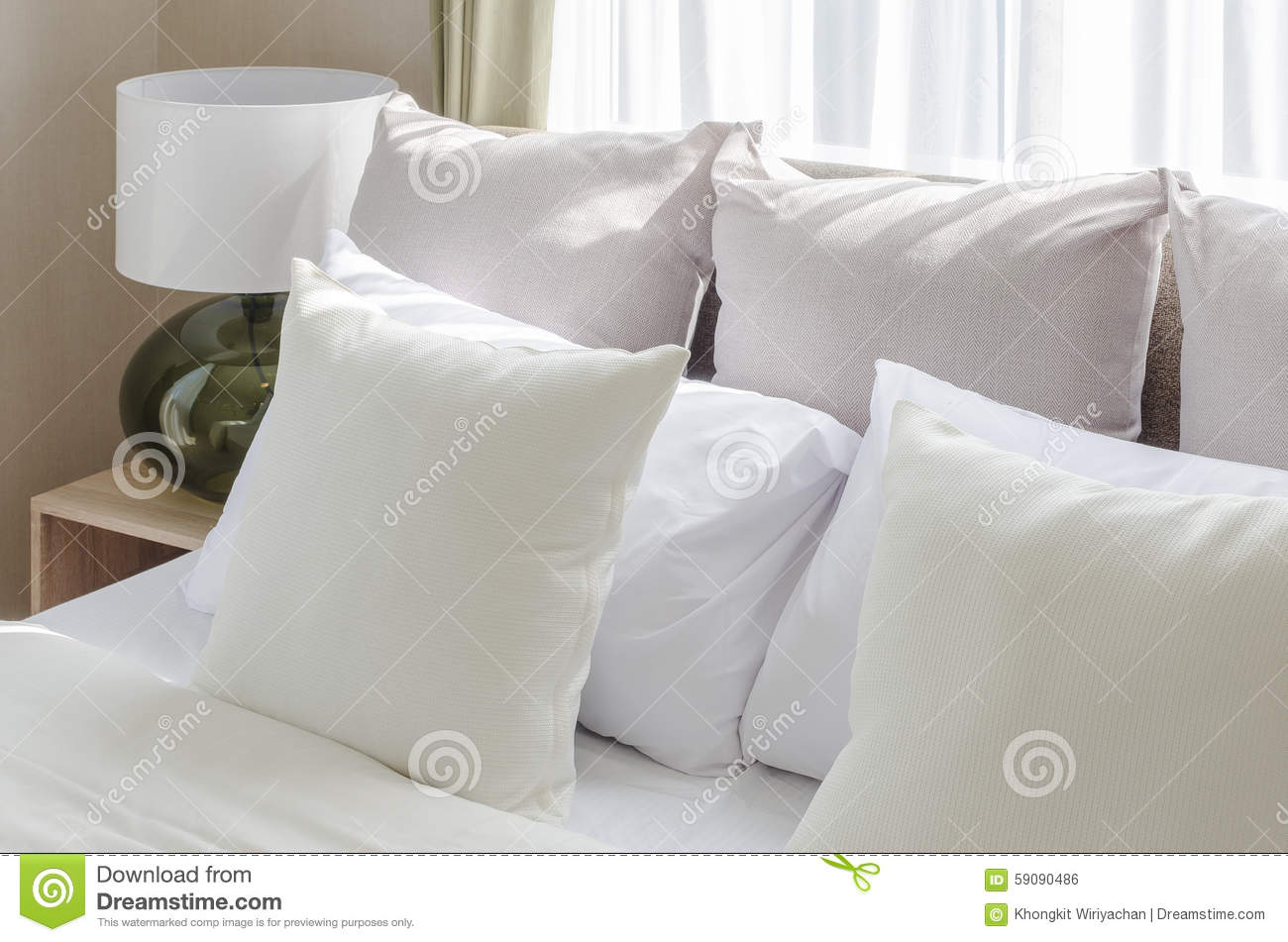 White pillows on bed in modern bedroom