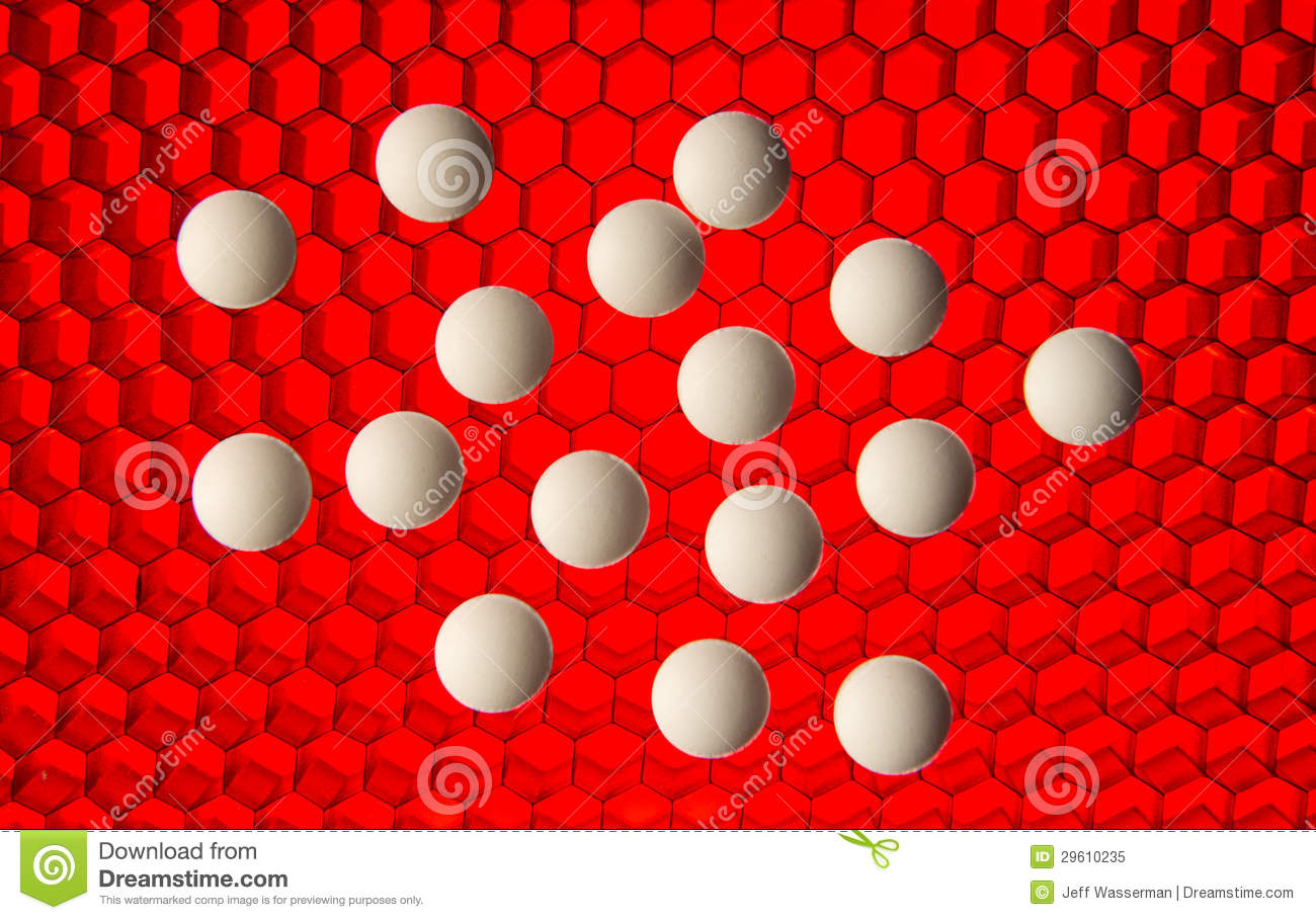 White Pills On A Red High Tech Grid Background Royalty
