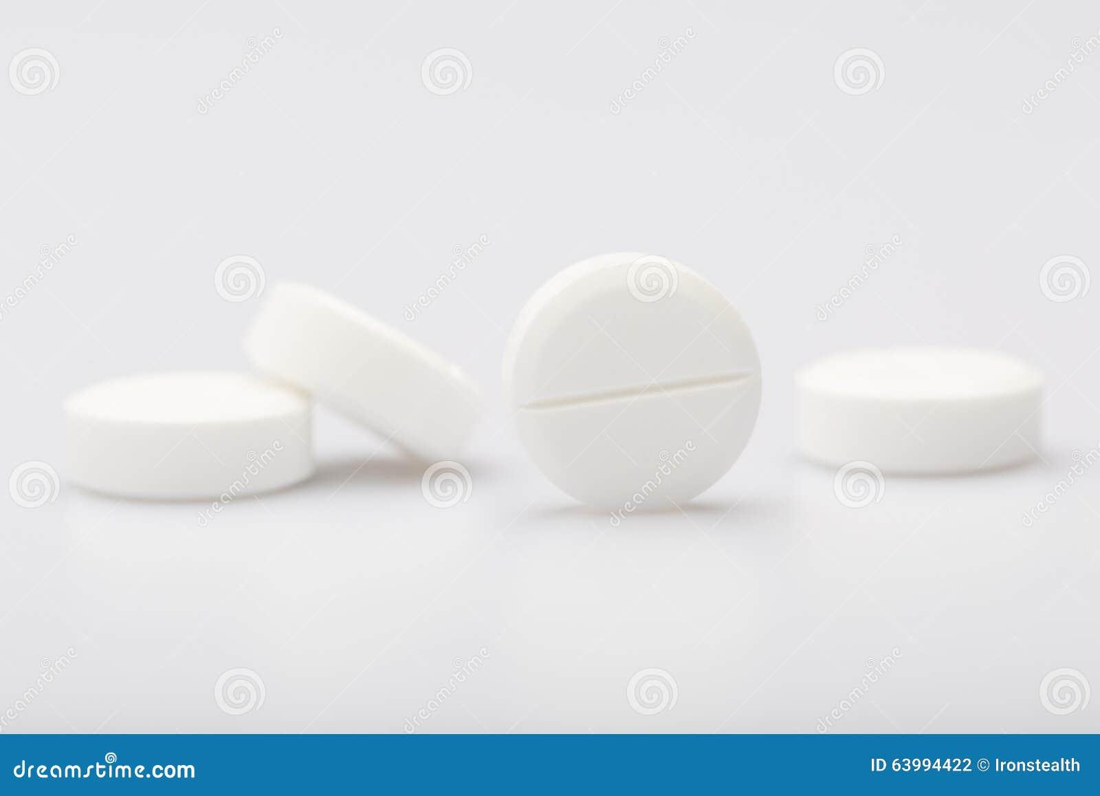 white pills on a white background stock photo image