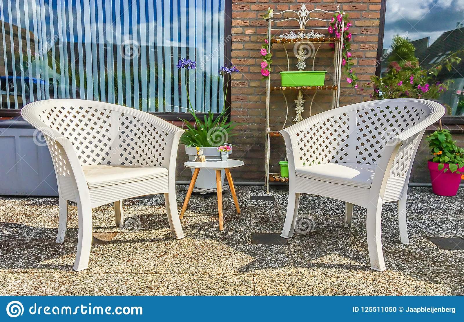 Prime White Plastic Lounge Chairs With A Small Wooden Table And Beatyapartments Chair Design Images Beatyapartmentscom