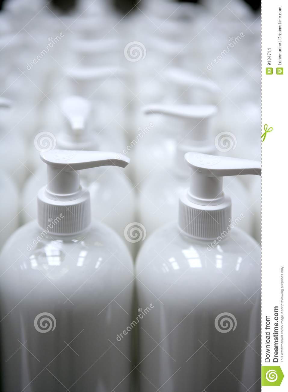 White Plastic Soap Bottles In Rows Assembly Line Stock