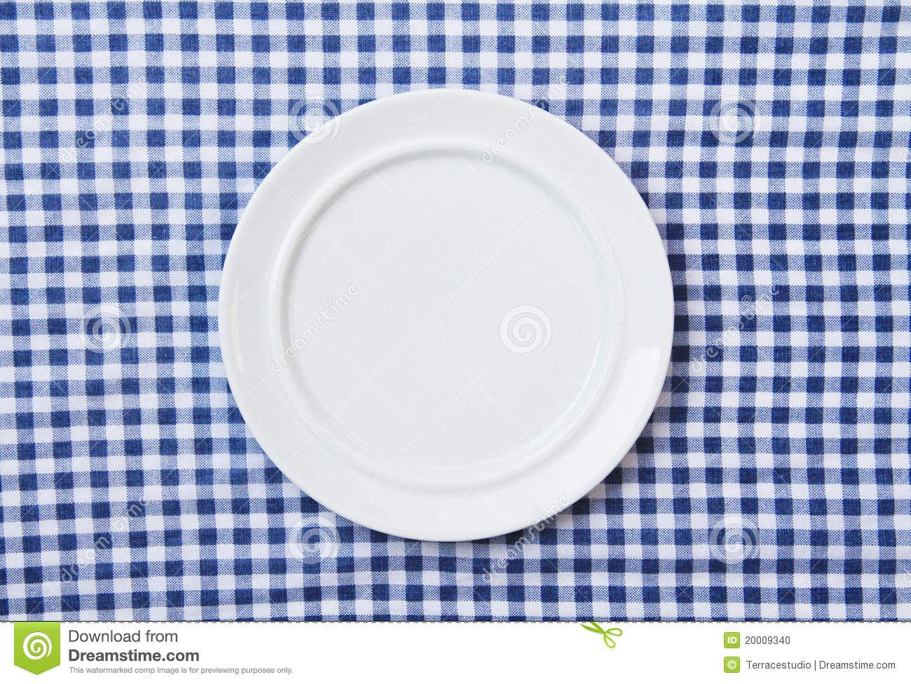 Blue tablecloth background - White Plate On Blue And White Checkered Fabric Stock Photo