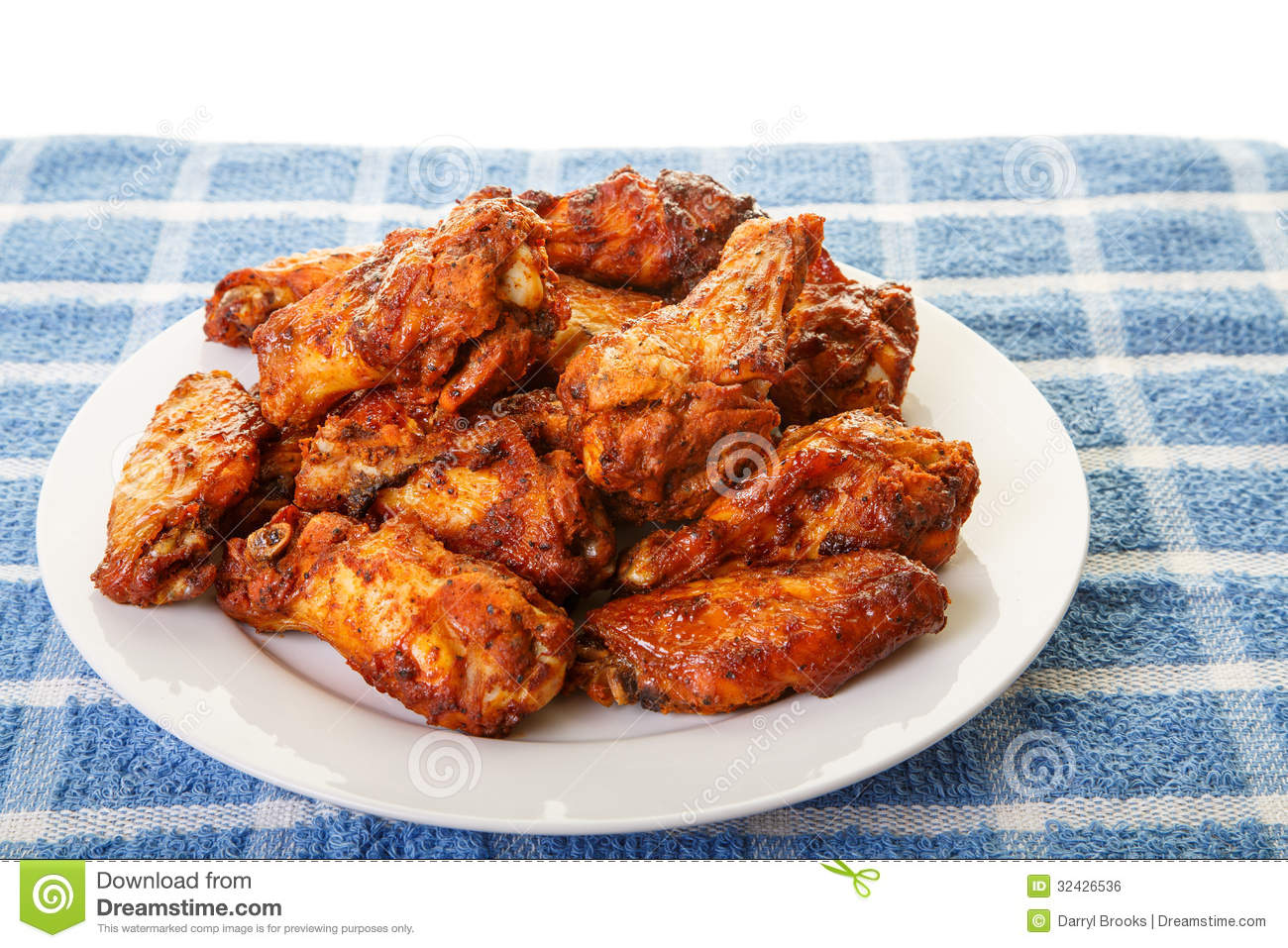 White Plate Of Chicken Wings On Blue Mat Royalty Free