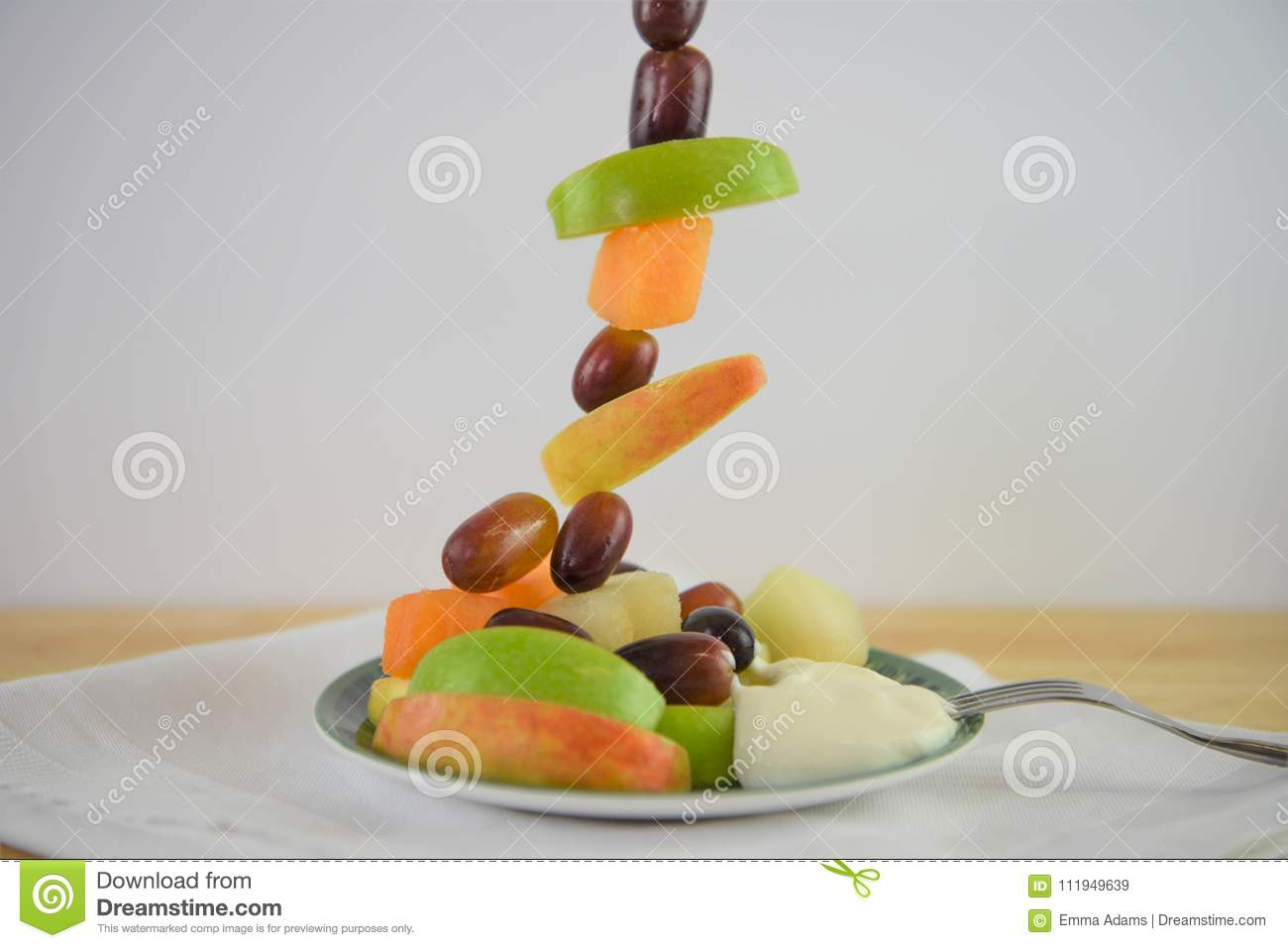 Bright fresh fruit and yoghurt served in a tall vertical line for a creative design