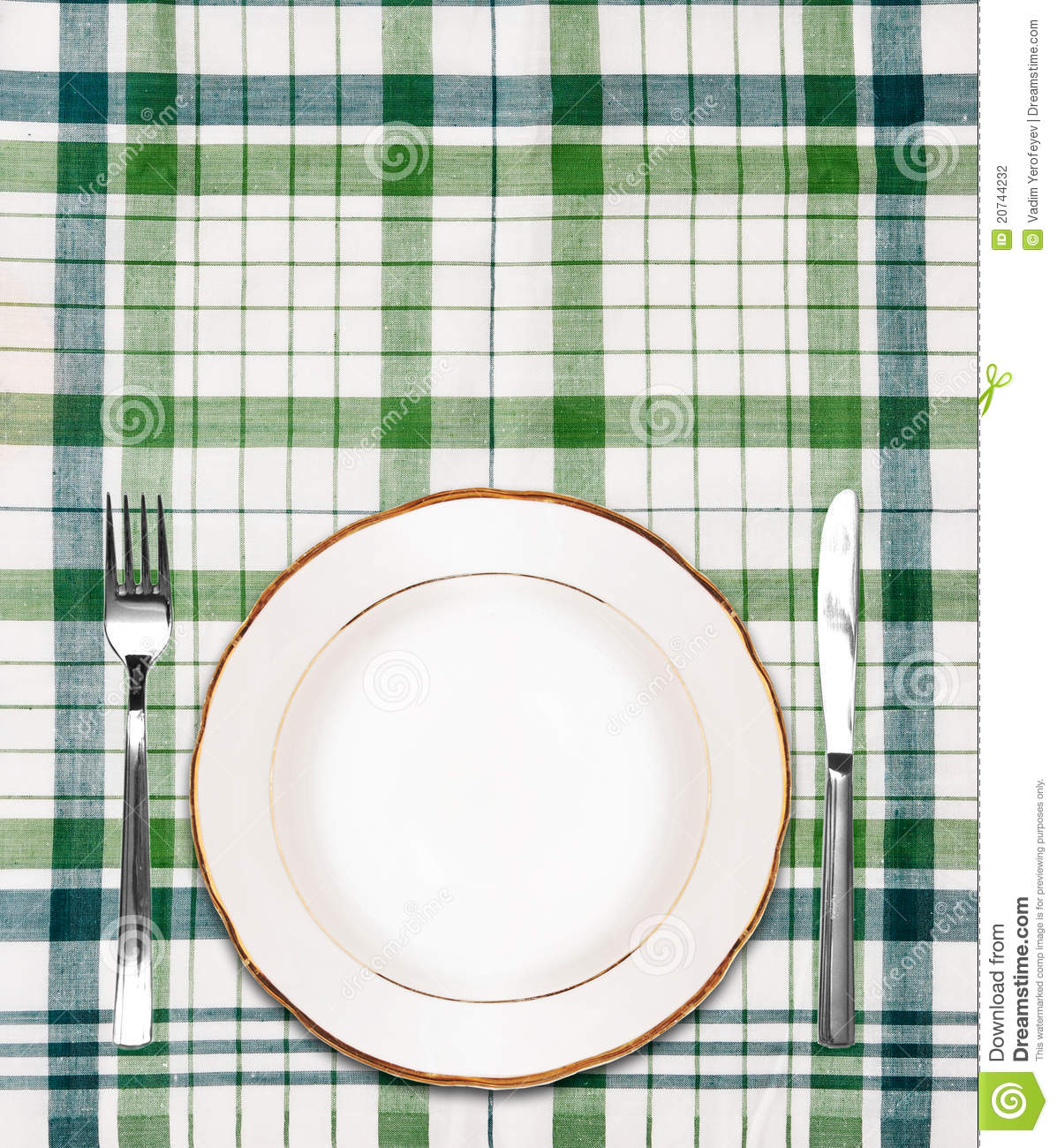 White Plate On Green Checkered Tablecloth Stock Photo