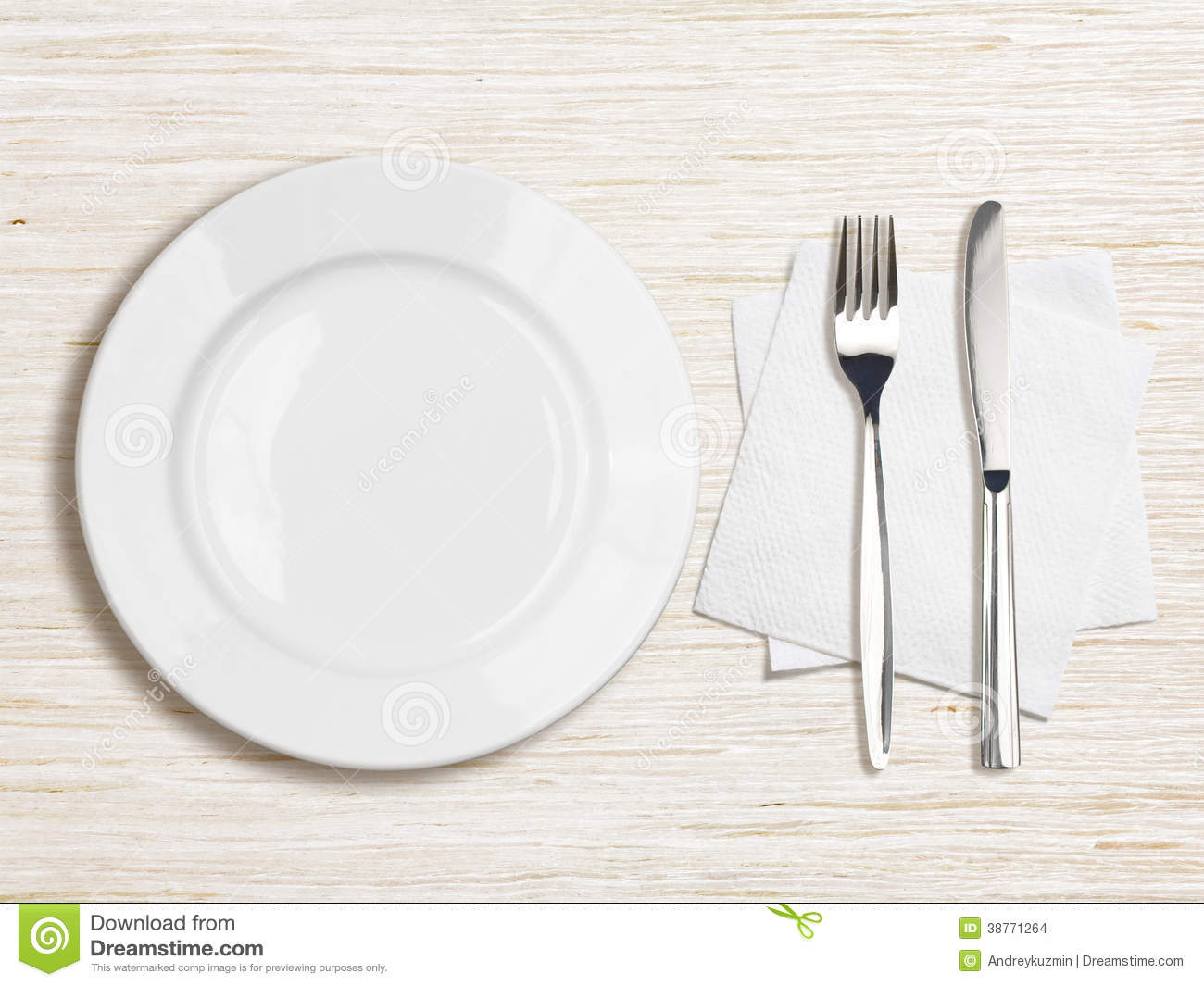 An empty white dish with knife and fork on a table - White Plate Knife Fork And Napkin Top View Stock Images
