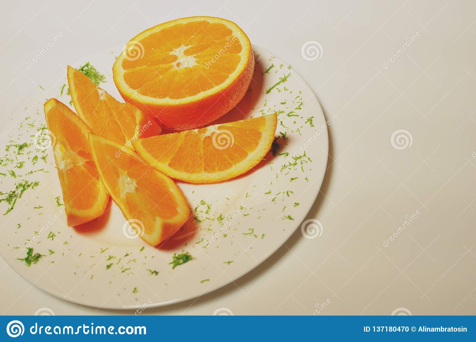 White plate with orange slices.