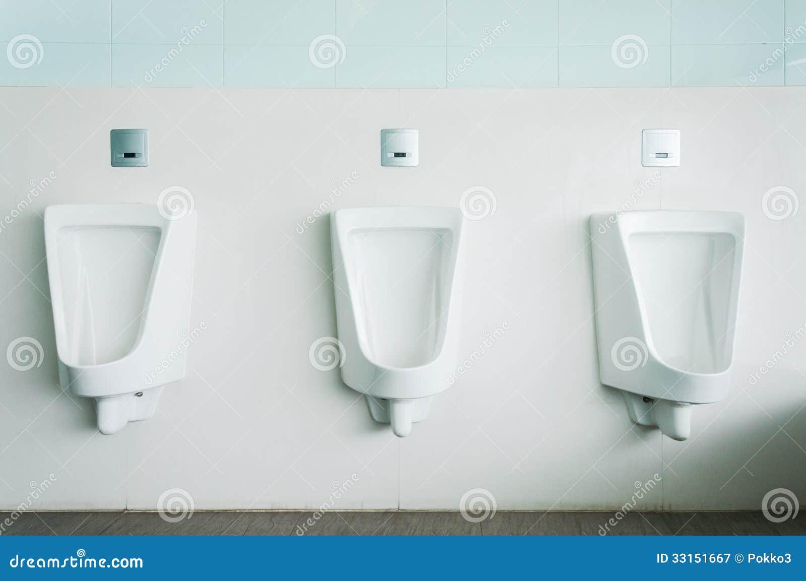 White porcelain urinals stock image. Image of porcelain -