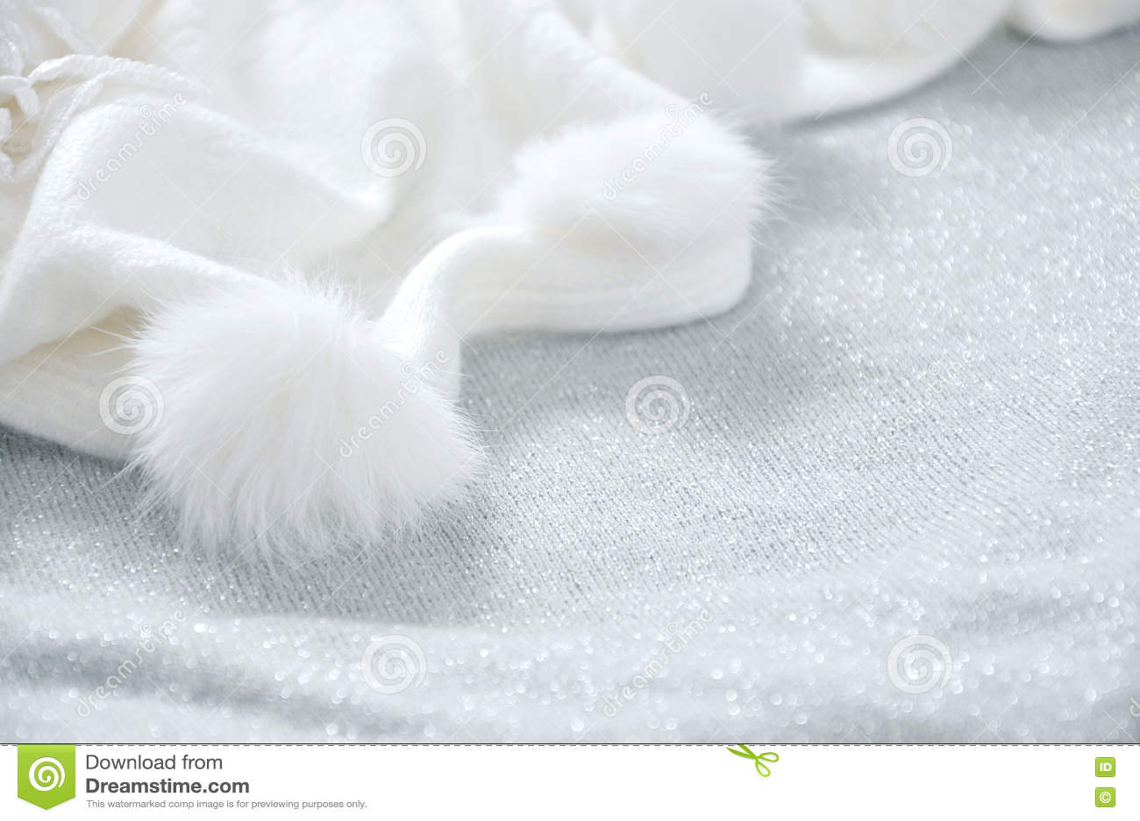White Puffy Scarf on Glitter Background