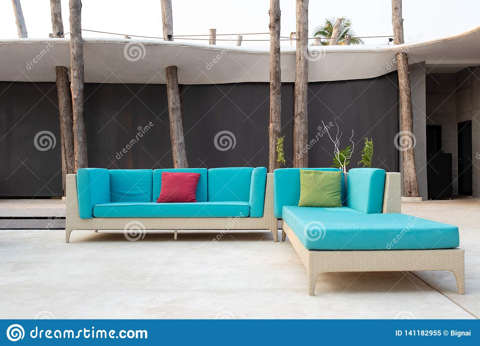 White Rattan Garden Furniture With Blue Cushion On Resort Terrace Stock Image Image Of Chair Landscape 141182955