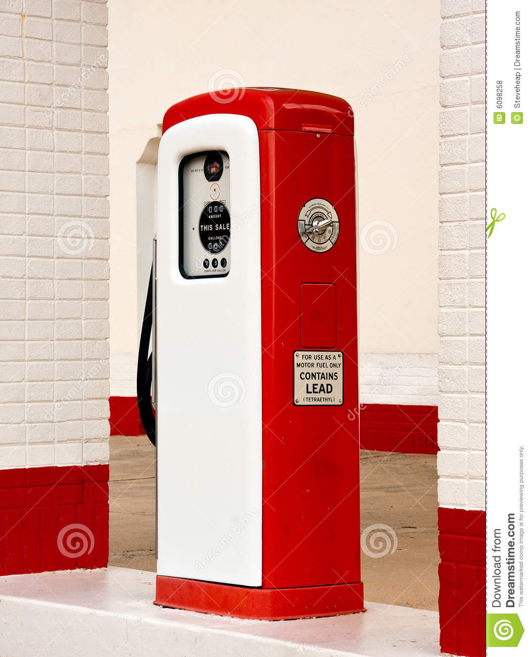 White and red ancient gas pump