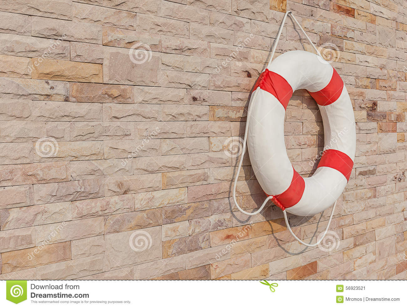 The White And Red Life Buoy Is Hanging On The Brick Wall Around Stock Image Image 56923521