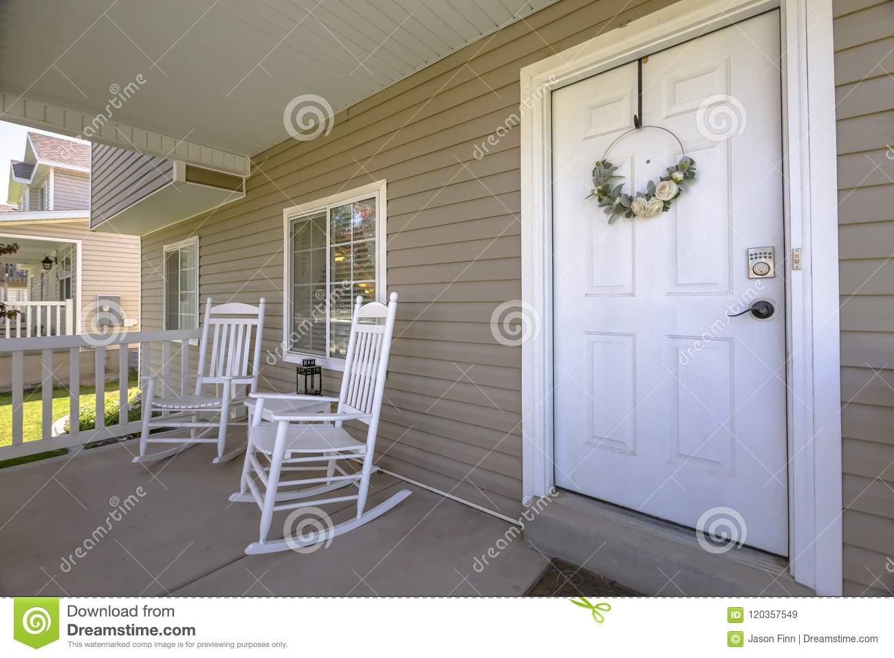 White Rocking Chairs And White Front Door Stock Image Image Of