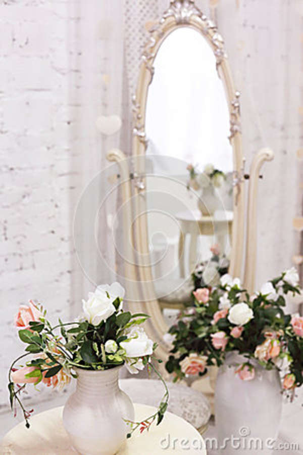 White room with mirror and vintage chair