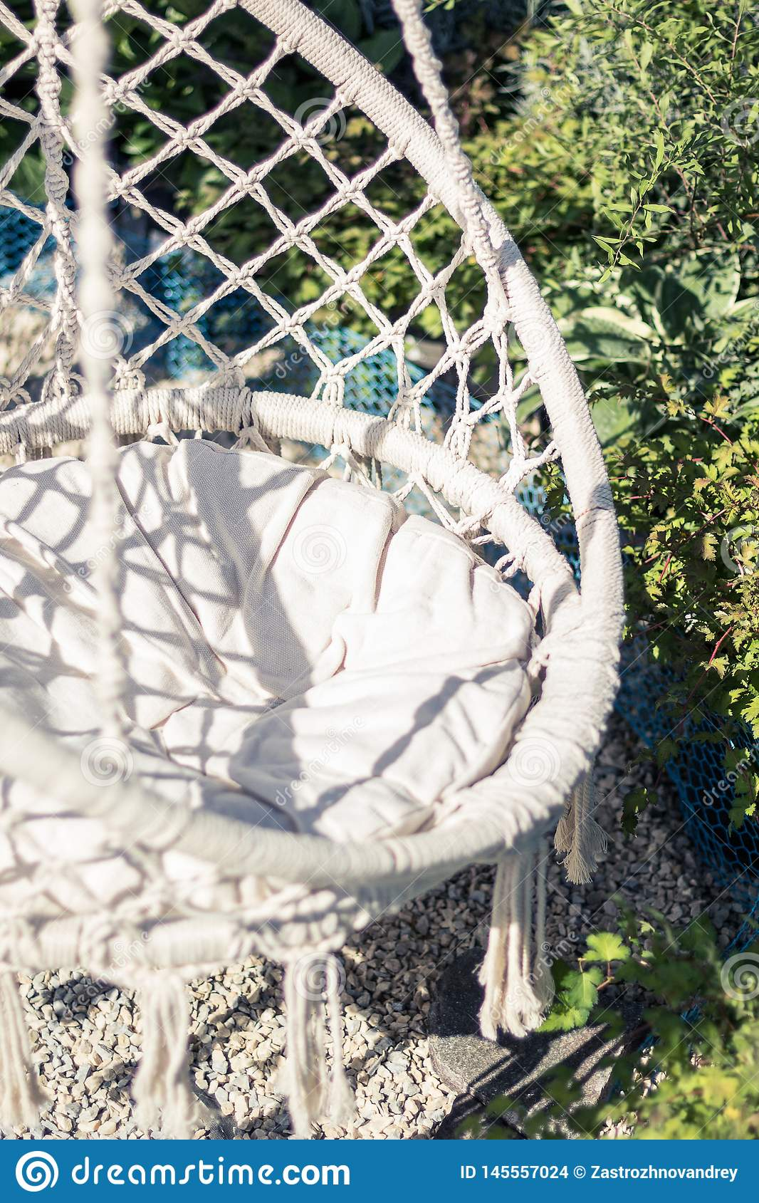 White rope chair in the garden. Close-up