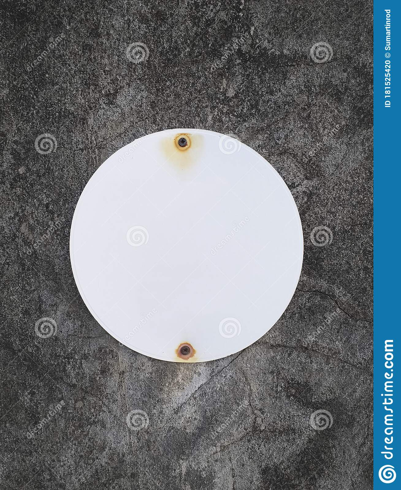 White Round Sheet Metal With Rusty Holes On Rough Gray