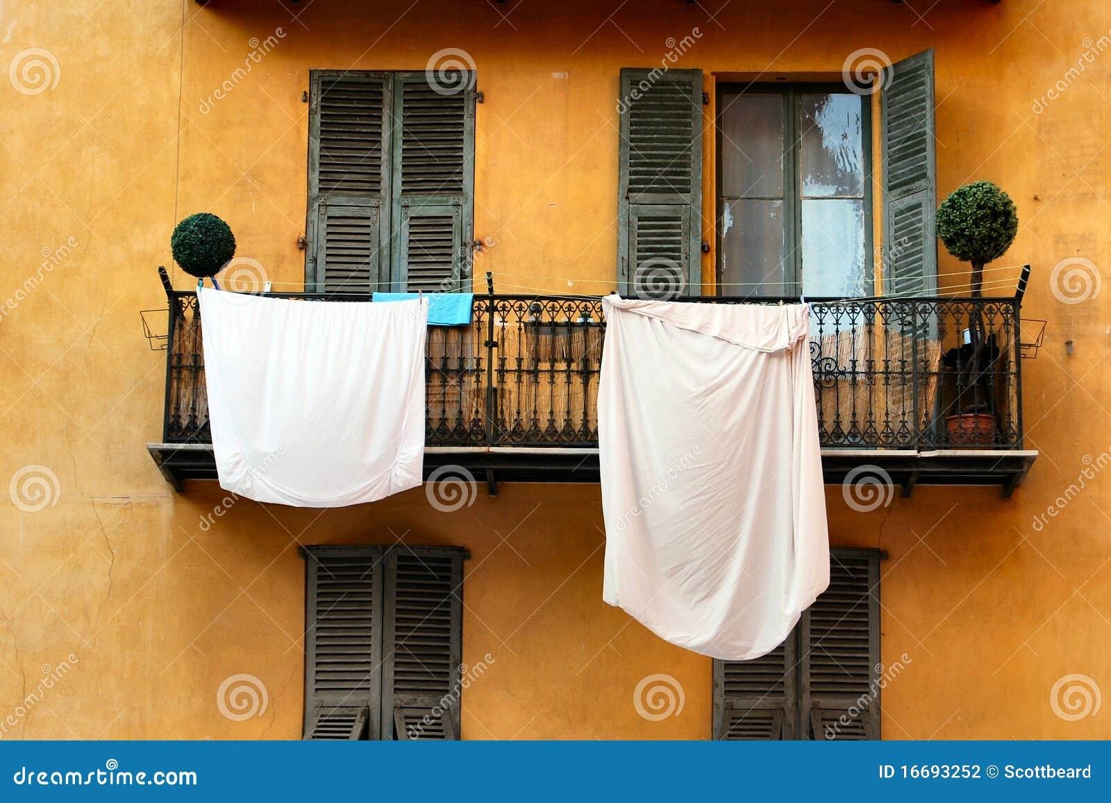 White sheets washing hanging on balcony stock photography image 16693252 - Wash white sheets keep fresh ...