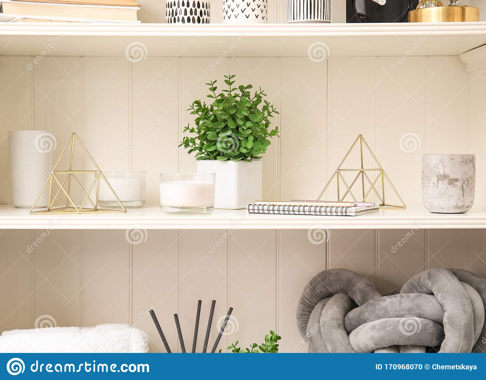 White Shelving Unit With Plant And Decorative Stuff Stock Photo Image Of Knitted Household 170968070