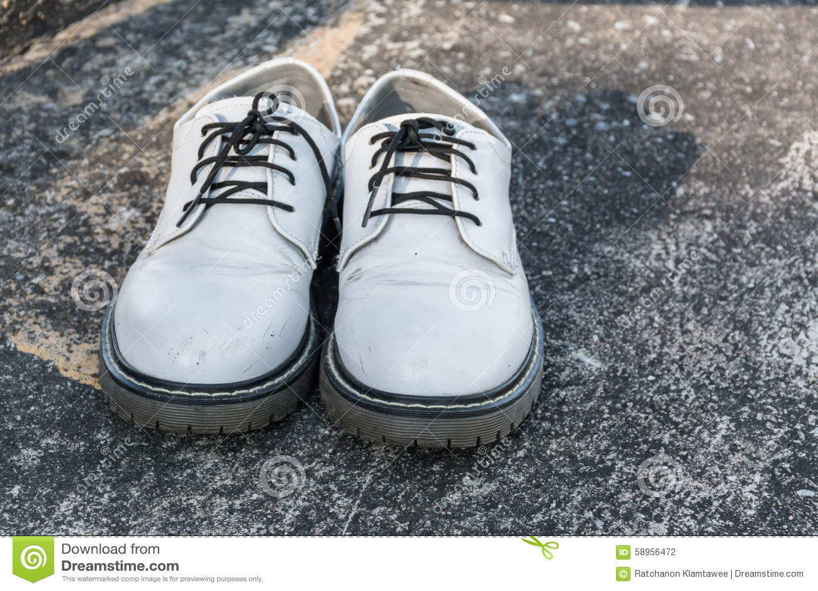 white shoes on concrete stock photo image 58956472