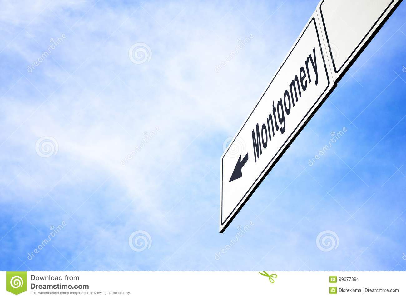 White Signboard With An Arrow Pointing Left Towards Montgomery Alabama Usa Against A Hazy Blue Sky In A Concept Of Travel Navigation And Direction