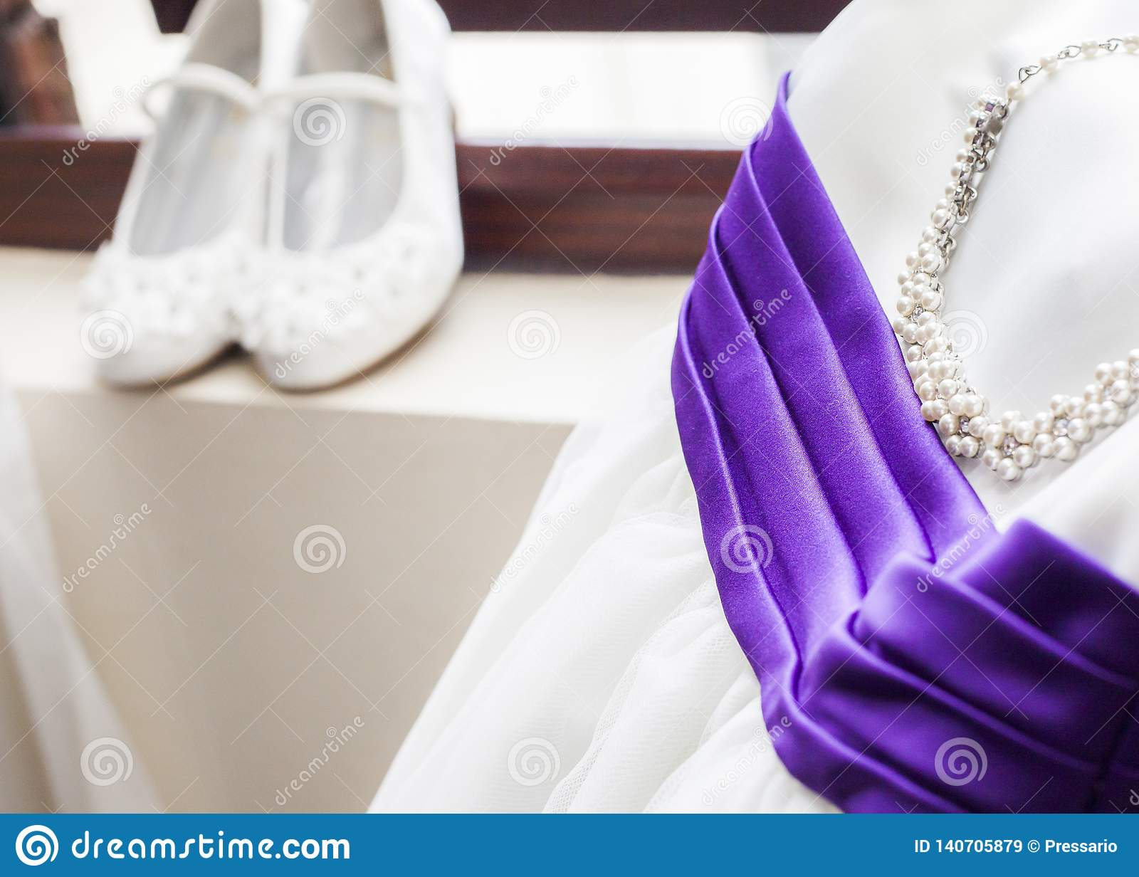 Silk Wedding Dress And Pearl Necklace With Purple Ribbon Stock