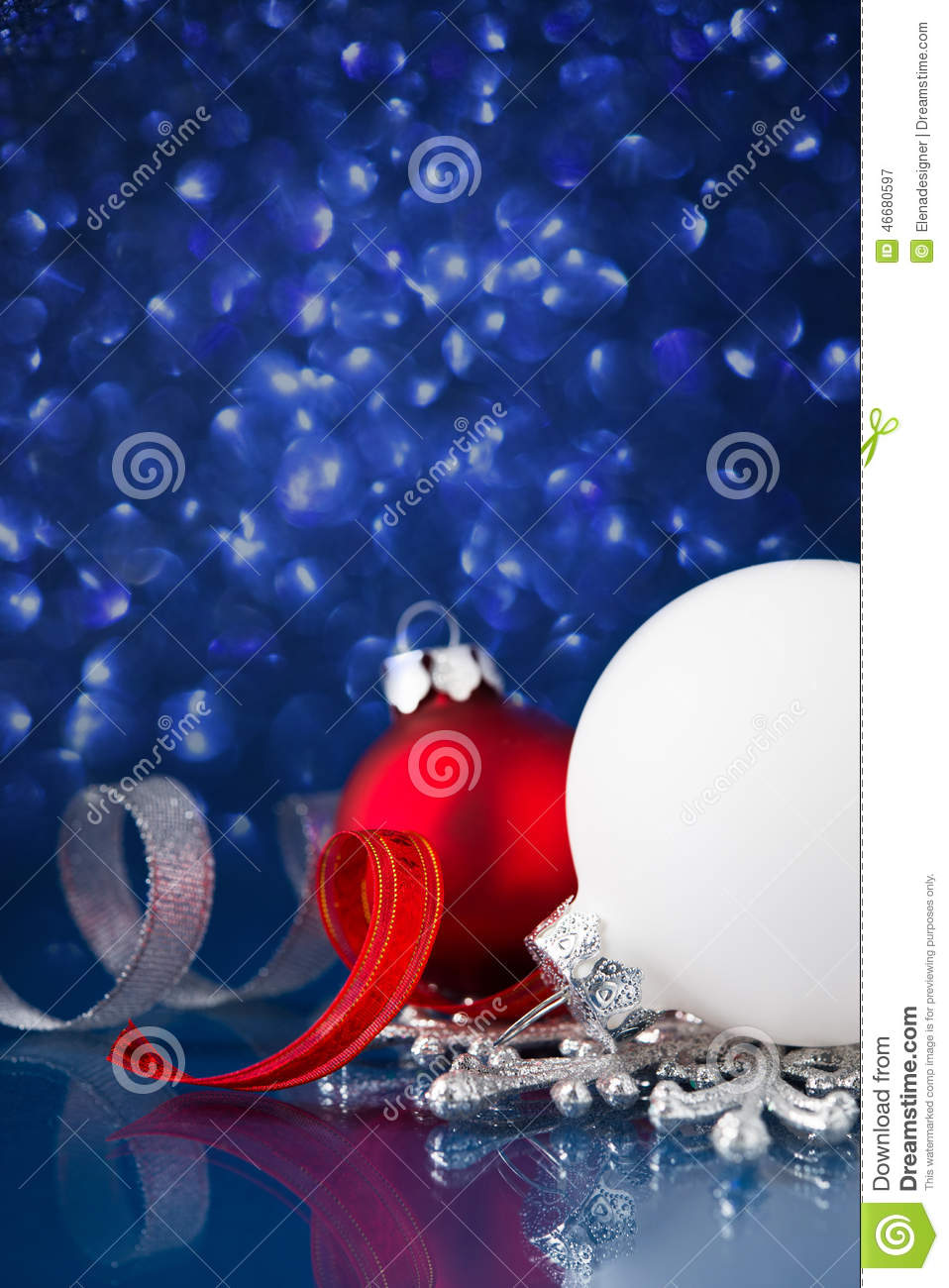 White silver and red christmas ornaments on dark blue