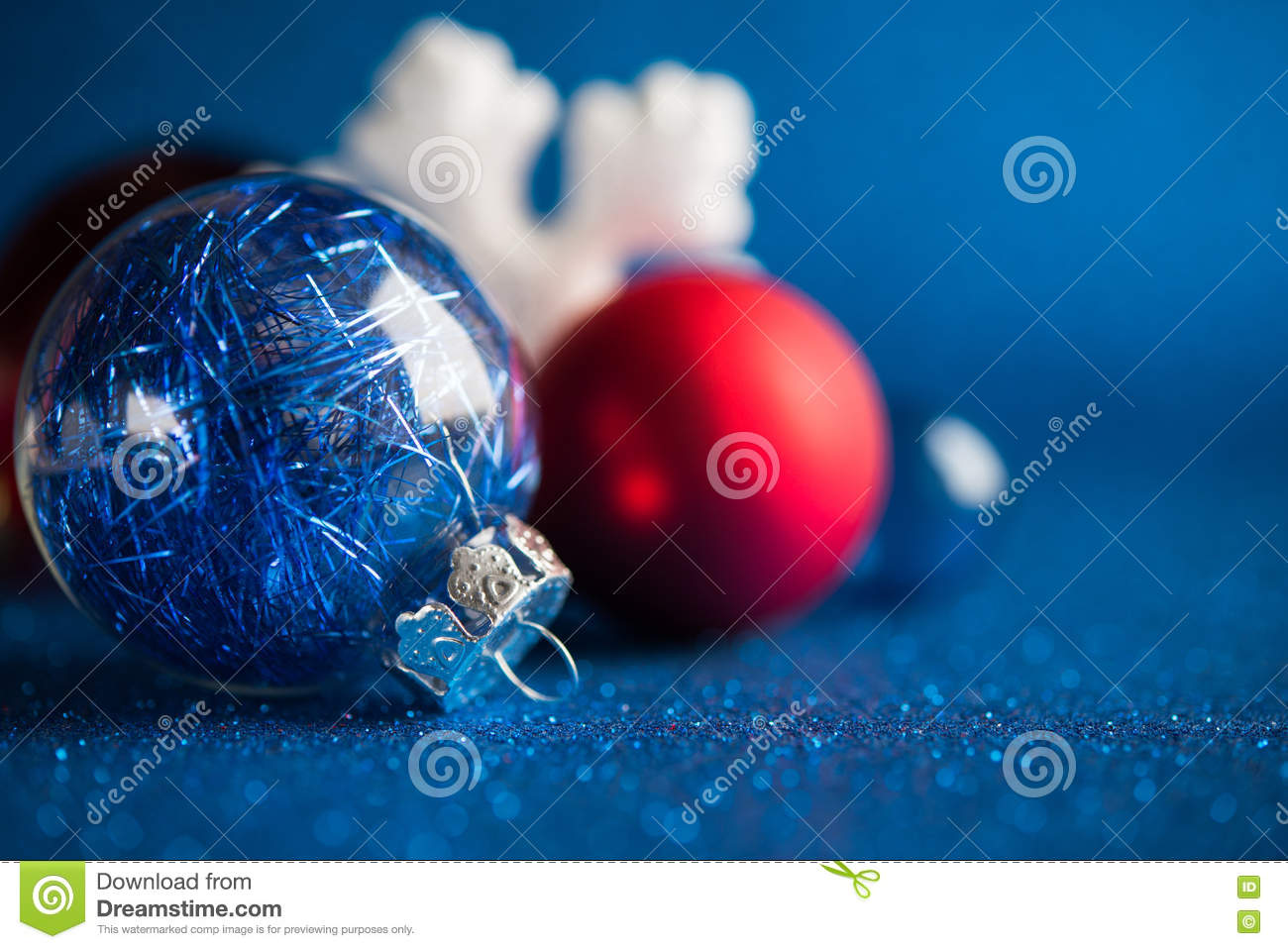 Red white and blue christmas ornaments - White Silver And Red Christmas Ornaments On Dark Blue Glitter Background Stock Image