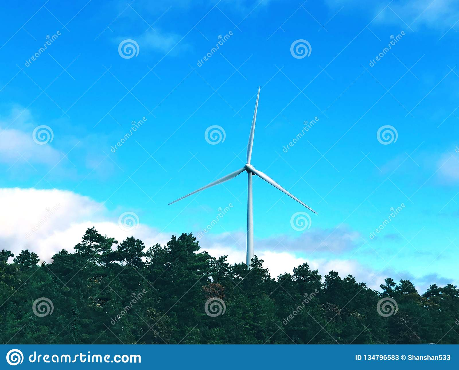 A white single wind generating by the highway