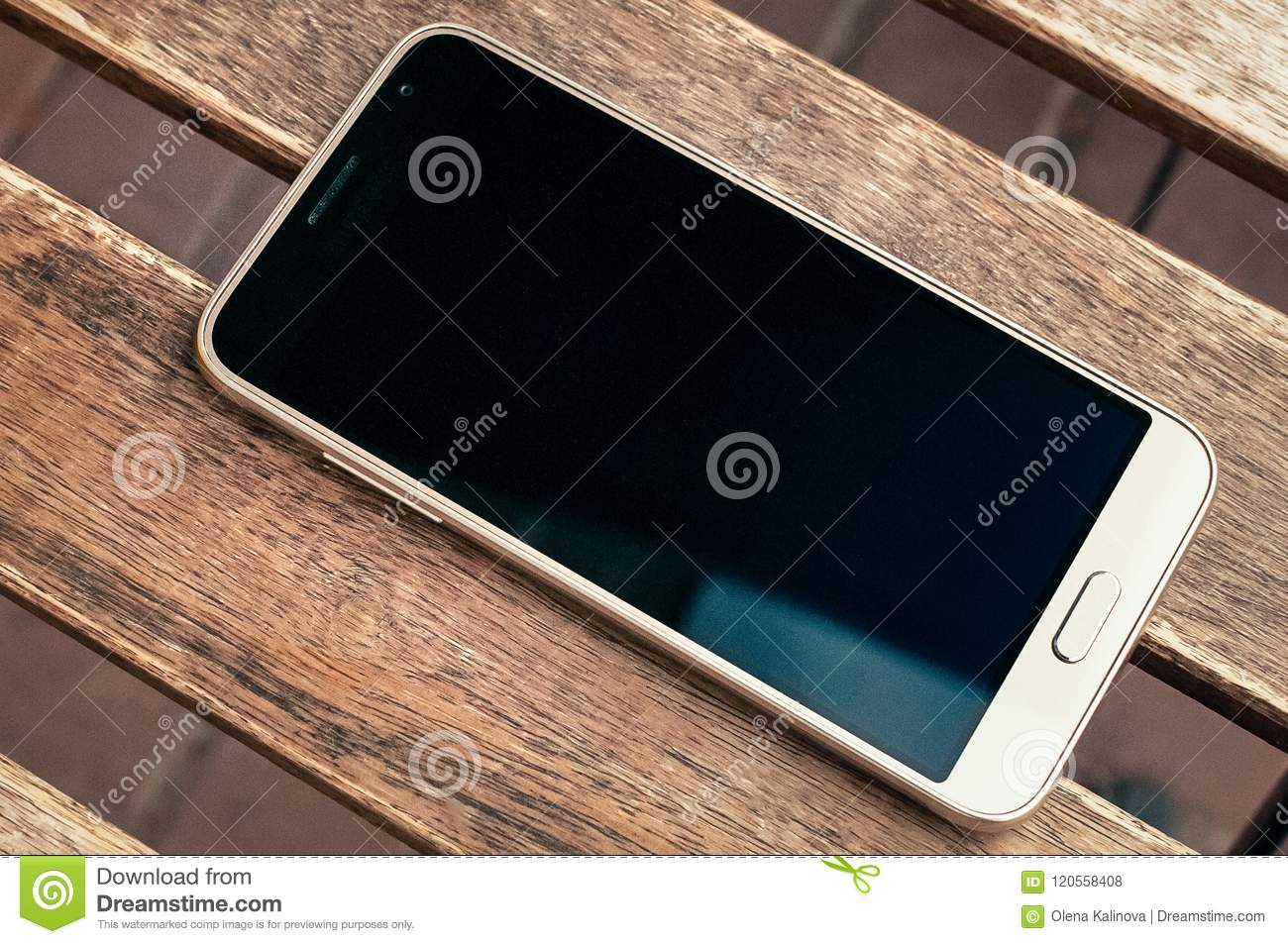 White Smartphone On Wooden Table Background Texture With Copy Sp