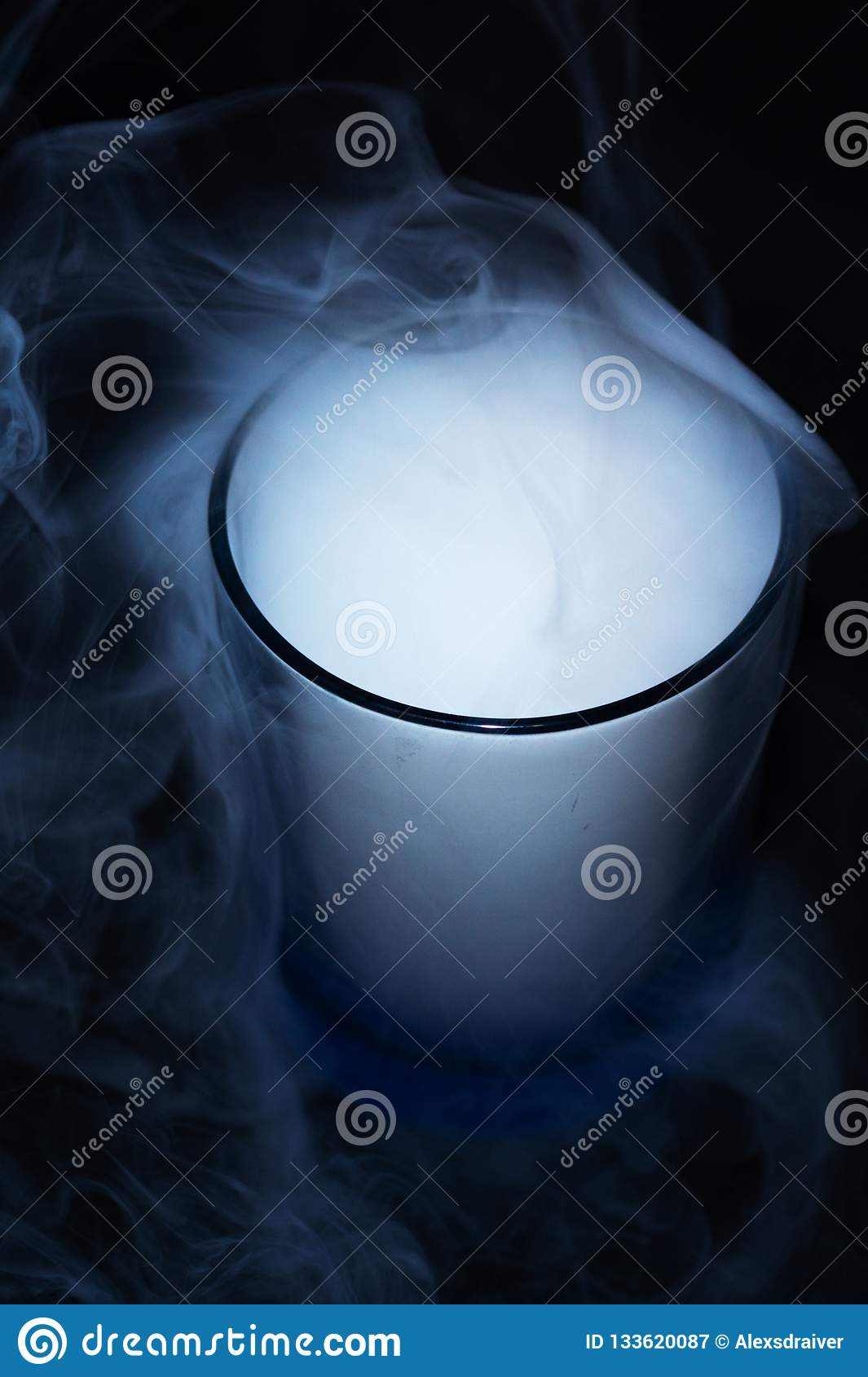 White smoke on black fabric background in glass. Smoke spreads over the background. Vaping culture, life without cigarettes.
