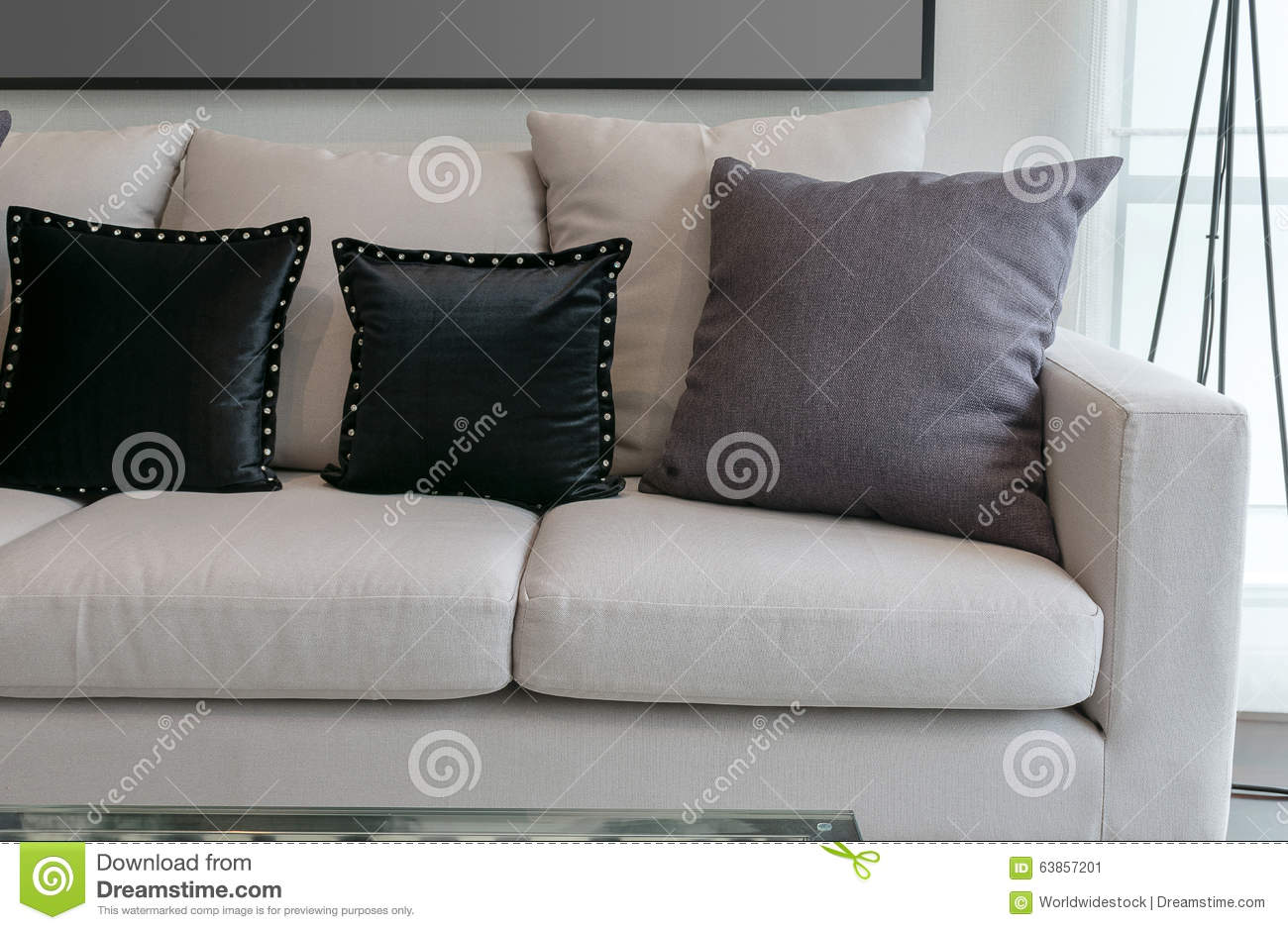 White sofa with black and grey pillows in living room for Black and grey sofa