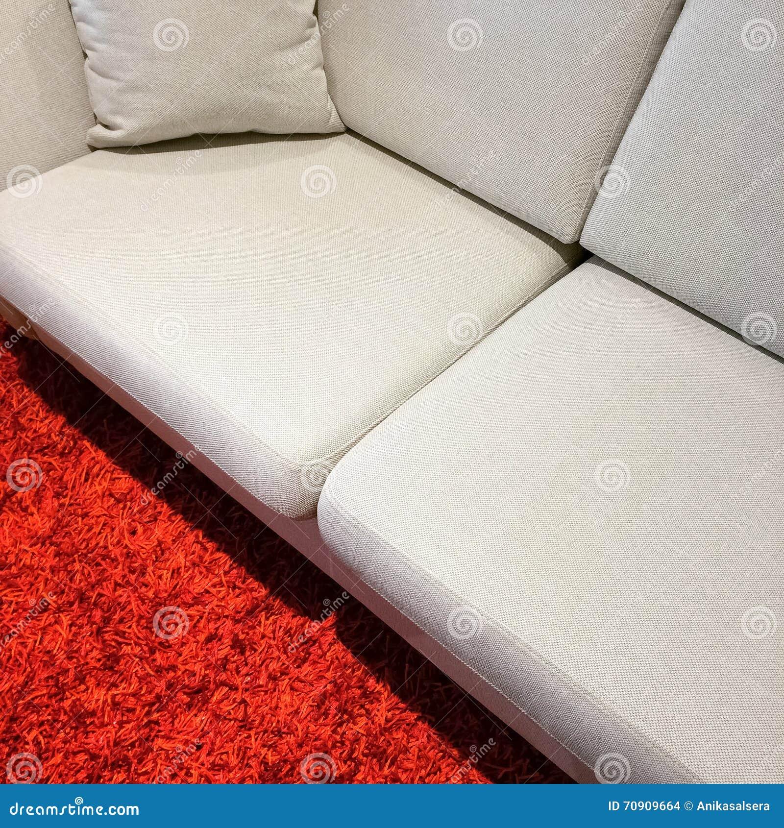 White Sofa On Red Carpet Stock Photo. Image Of Detail - 70909664