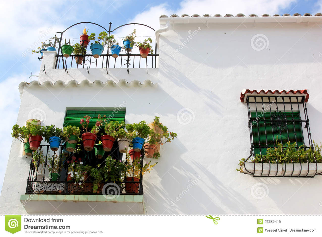 White Spanish House With Balconies And Plants Royalty Free
