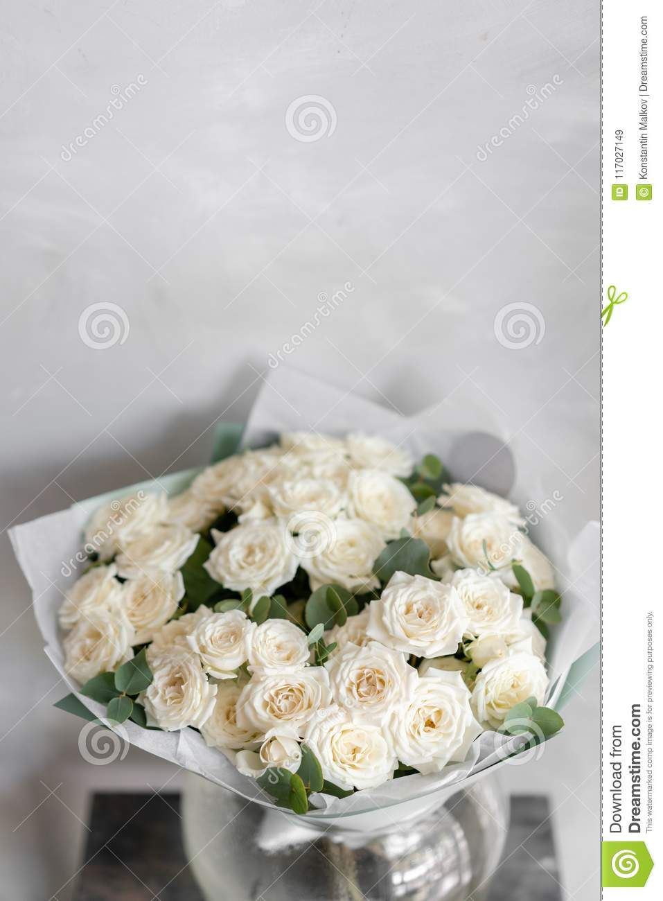White Spray Roses Bouquet Of Beautiful Flowers On Wooden Table