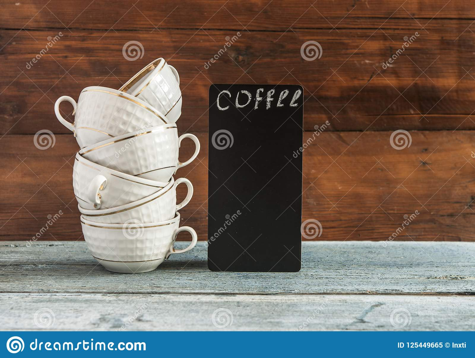 Stack Cups And Small Blackboard On Wooden Table Stock Image Image