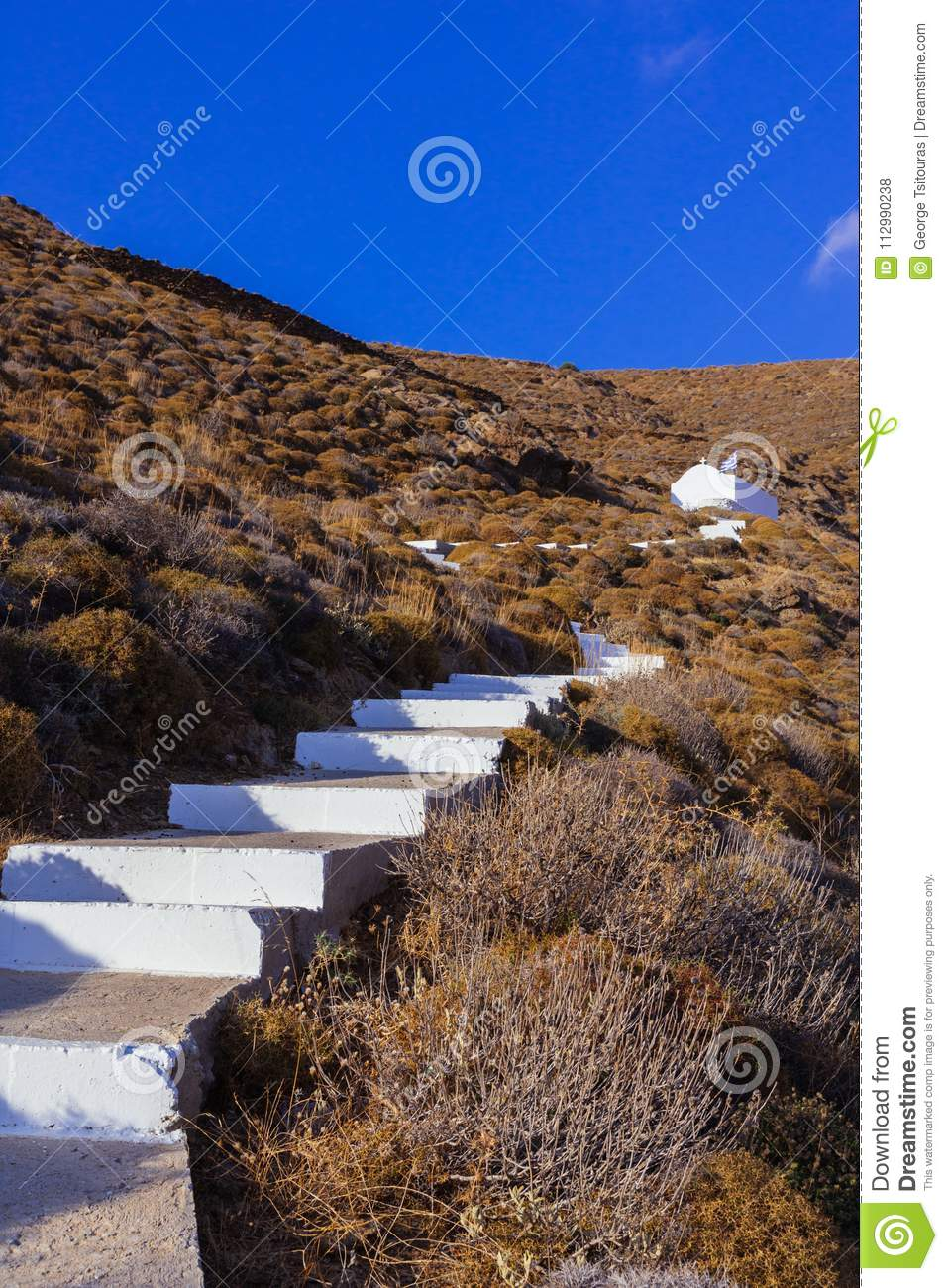 White stairs that lead to a little chapel on the mountain