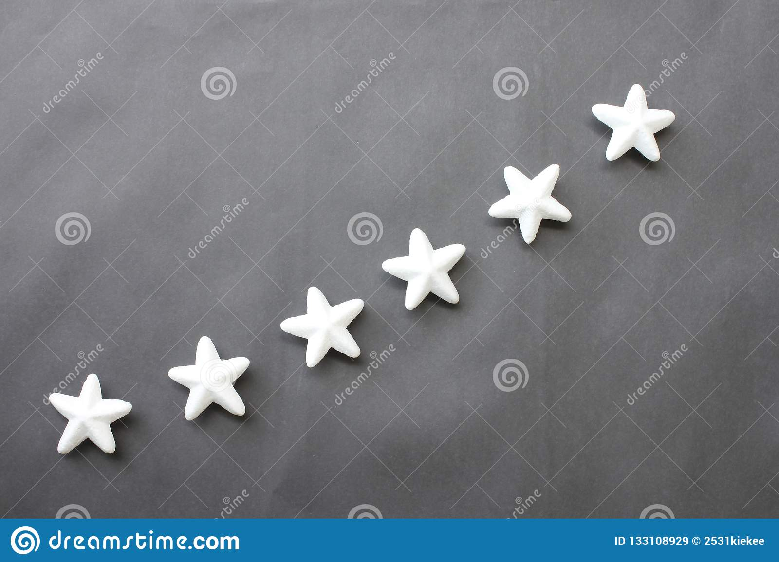 White Stars Are Placed On A Black Background For Business Ideas