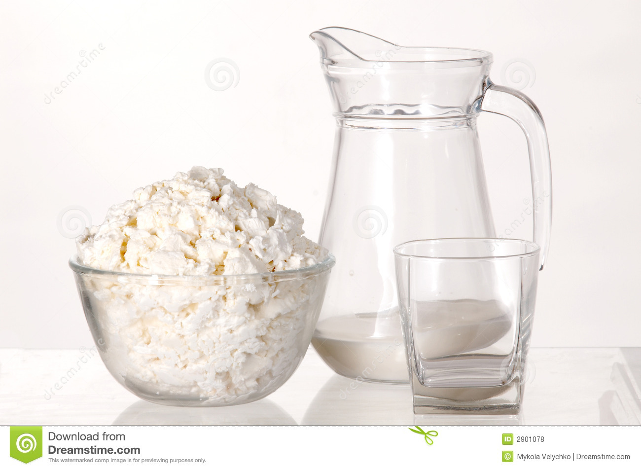 White still-life with milk and cottage cheese on white background.: dreamstime.com/royalty-free-stock-photos-white-still-life-image2901078